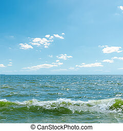blue sky over sea with waves