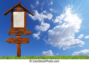 Double Directional Wooden Signs on Blue Sky - Wooden...