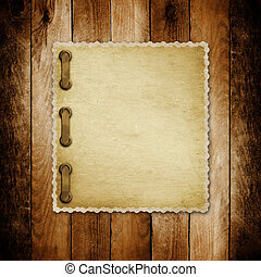 Grunge paper for invitation on the vintage wooden background