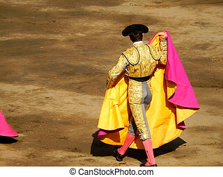 Bullfighter in the ring. brave matador with capote. arena