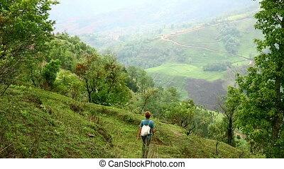 Female caucasian tourist trekking walking at himalayan mountains, Nepal