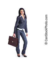 Attractive Business woman holding a briefcase standing on...