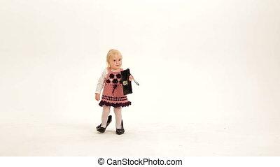 Little mod - Little girl with a purse wearing high heels