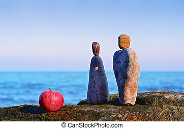 Yin and Yang - Apple and stones as symbol of man and woman