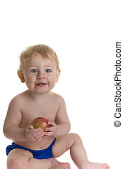 Happy baby holds apple - Happy baby holds and eats apple