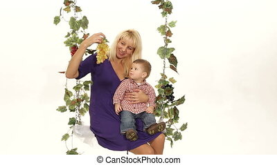 Eating grapes - Mother proposing grapes to her son