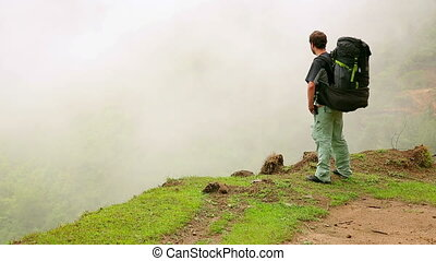 Male caucasian tourist trekking walking at himalayan...