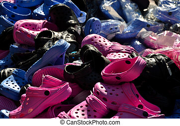 many colorful shoes - many colorful plastic shoes on a...