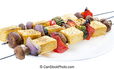 Tofu kebab - Grilled tofu mushroom kebab on skewer served on...