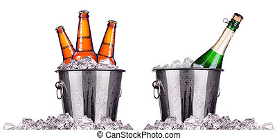 Beer and champagne bottles in ice bucket isolated on white