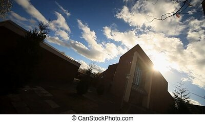 Church With Sun and Clouds