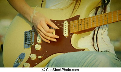 Guitar accord. Old movie - Playing guitar accords. Close-up....