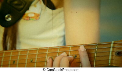 Guitar chords. Old movie - Playing guitar chords. Close-up....