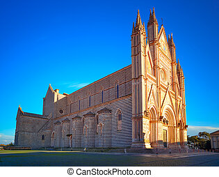 Orvieto medieval Duomo cathedral church on sunset Italy -...