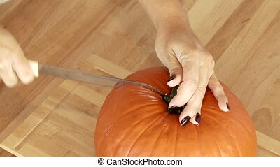 Cutting a Pumpkin - Video footage of cutting a pumpkin in a...