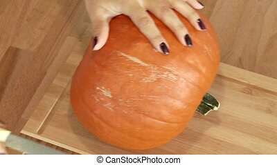 Woman Cutting a Pumpkin