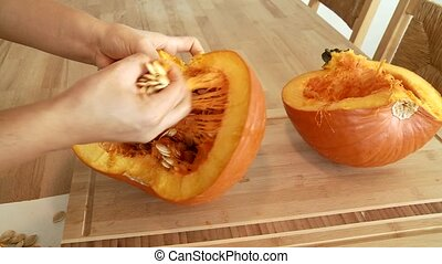 Woman prepares a Pumpkin - Video footage of preparing a...