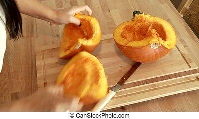 Cutting a Pumpkin - Video footage of preparing a pumpkin in...