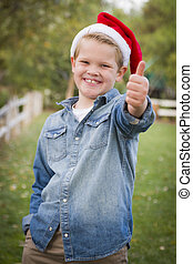 Young Boy Wearing Holiday Clothing Giving a Thumbs Up Outside