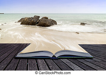 Creative concept pages of book Sennen Cove beach before sunset in Cornwall England