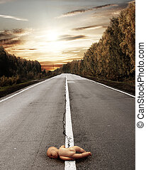 Doll on road - Conceptual image - death of the child on road
