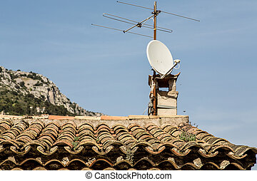 Old TV Antenna and Modern Dish on Roof - An old Television...