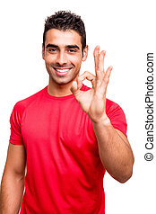 Man showing Ok sign over white background