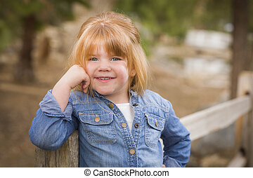 Cute Young Girl Posing for a Portrait Outside - Cute Smiling...