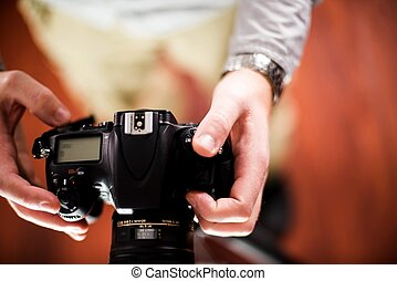Professional Camera in Hands of Photographer. Photography...