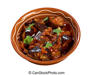 Sicilian Caponata with  pine nuts .farm-style.isolated