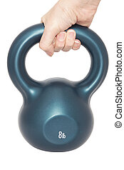 Hand holding kettlebell - close up of a womans hand holding...