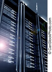 Modern Data Center with Lens Flare. Servers Racks - Dark...