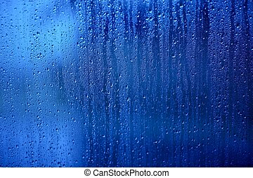 Wet Glass. Water Drops on the Blue Glass - Background,...