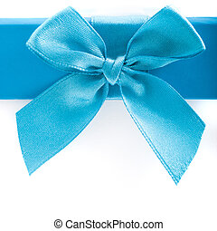 Pretty blue bow and ribbon on a gift box lid - Close up of a...