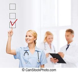 doctor or nurse drawing checkmark into checkbox -...