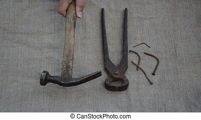 nails tongs hammer hand - Rusty tongs, hammer tool and bent...