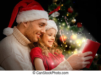 smiling father and daughter reading book - family,...