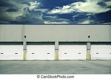 Four Warehouse Gates - Four Warehouse Truck Docks. Business...