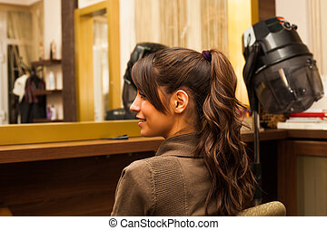 ponytail - smiling young woman hairdo at hairdressing salon