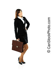 full body picture of successful business woman walking with...