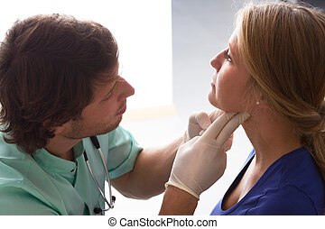 GP examining woman - GP examining young woman, who has...