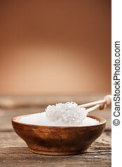 White sugar in wooden bowl