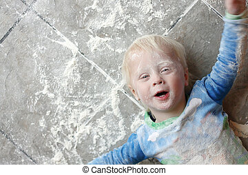 Messy Baby Covered in Baking Flour - a one year old small...
