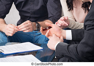 people signing a document - Hands of people signed the...