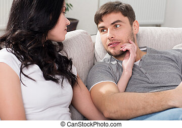 loving couple sitting on a sofa in the living room