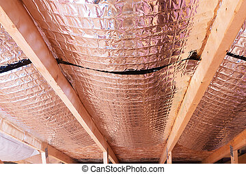 Insulating of attic with fiberglass cold barrier and...