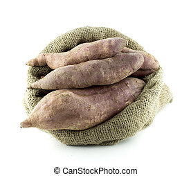 sweet potatoes in burlap sack isolated on white background