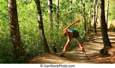 Sexy girl exercise in forest