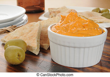 Hummus and pita bread - Garlic and red bell pepper hummus...