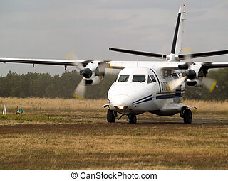 Commuter plane on taxiway - Small turboprop commuter plane...